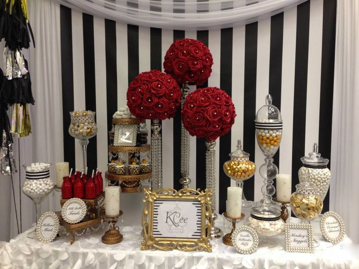 Red, white and black inspired candy buffet by Kcee's Candy Buffets http://kceescandybuffets.com/index.html looking Fabulous on Opulent Treasures cake stands and candelabras