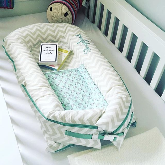 "No wonder babies have a hard time sleeping in big cribs after being surrounded and snug in the womb. Our crib insert baby pods make babies feel instantly at ""home."" #sleepyheadofsweden @waceystyle"