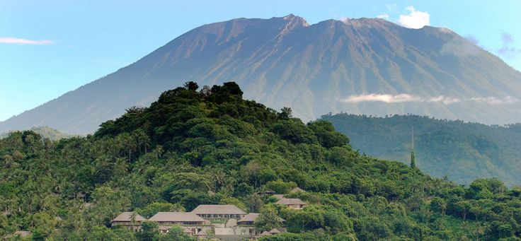 Mount Agung provides a dramatic backdrop for Amankila (peaceful hill), a…