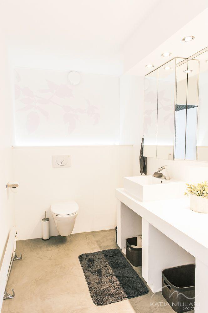 White toilet with concrete floor. Katin Kokeelliset Remontit: kesäkuu 2014