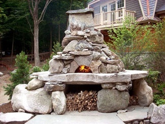 Outdoor Pizza Oven - would look good at my place with all or our granite rocks and boulders.  Some day!