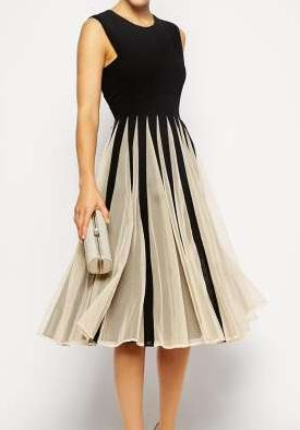This sophisticated cocktail dress will garner compliments on any occasion.