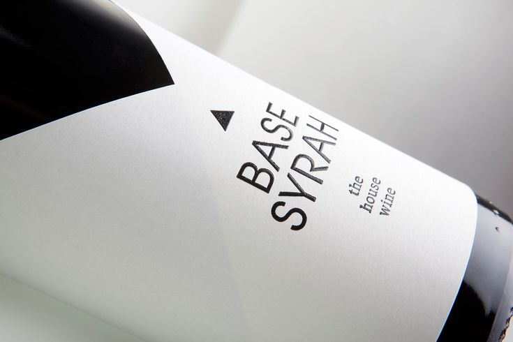 G Design Studio created the name and label for 'Base Syrah', the house wine of Base Grill restaurant, depicting on the label the shape of the plain white napkin, traditionally used by waiters to serve wine – an image that is familiar and classic at the same time. The triangle in the logo symbolizes the idea of a house.