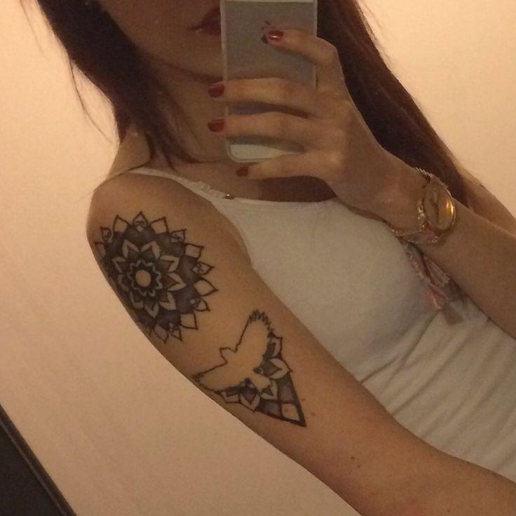 Mandala and bird tattoo