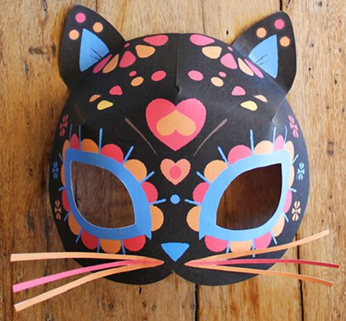 Easy to make cute sugar skull cat masks. Photo tutorial and 2 FREE templates. Day of the Dead cat mask template, plus color in your own class worksheet!