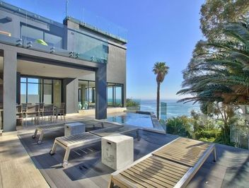 Enjoy breath taking sea views in this lavish 6 bedroom villa in trendy #CampsBay. #SellingHouses #luxury