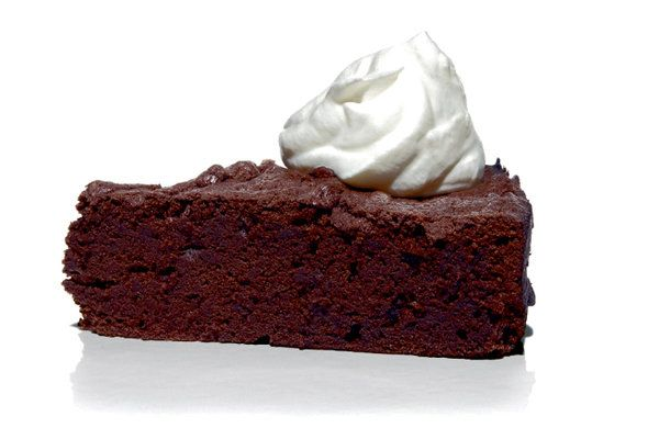 Just as there will always be a place in the world for an understated but luxurious black dress, there will always be a place for flourless chocolate cake. (Photo: Tom Schierlitz for The New York Times)