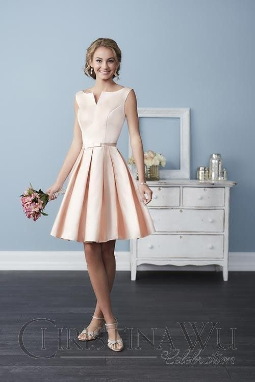 Take things up a notch in this pleated A-line Christina Wu 22757 knee-length bridesmaid dress. Its notched neckline and bow belt make it unique. Chic and sleeveless, a bateau neckline stretches shoulder to shoulder with a notched V in the center. Princess seams create shapely lines, meeting a thin satin bow belt that defines the waist. Perfectly pleated, the skirt hits just above the knee, with crisp pleats that go all the way around. A V-backline and hidden zipper finish the look.