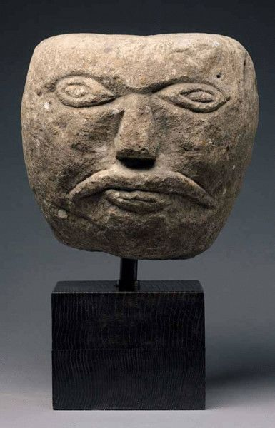 Carved Celtic Stone Head, c. 1-199,  with a typical down-curved moustache and spectacled eyes, probably Northern England. The symbol of the severed human head is as representative of the Celtic religion as is the cross for Christians. From the human skulls found in Celtic hill forts it is known that the head served as a military trophy testifying to the prowess of the warrior. The powers believed to be inherent in the head were thought to act protectively and keep evil from the community.