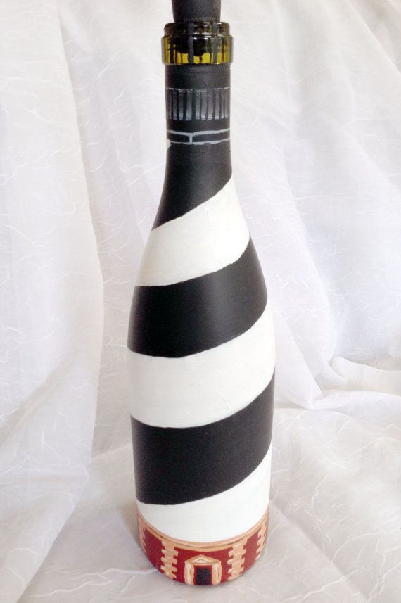 I thight this was well done. I wonder if any have been sold? Wine Bottle Lighthouse Cape Hatteras by CreativeChameleon on Etsy, $25.00