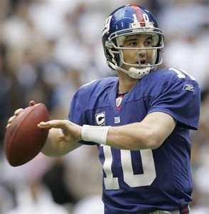 2 time Giants Super Bowl quartback Eli Manning in action...