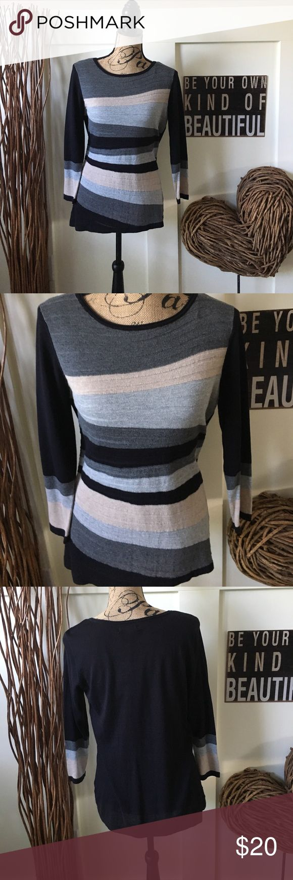 Dana Buckman expressive lines knit top Dana Buchman three-quarter length sleeve, knit top has a scoopneck and geometric stripes that are very flattering to your figure. This top looks great with your favorite pencil skirt or trousers. Dana Buchman Tops