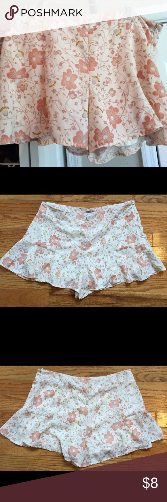 Flowy Floral Shorts - NWOT Never worn! They are a size small, but fit more like a medium. Light pink floral pattern. The fit is super flattering, they zip up on the side and the bottom of the shorts flare out a little bit like a skirt. The lining on the inside is silk. Forever 21 Shorts