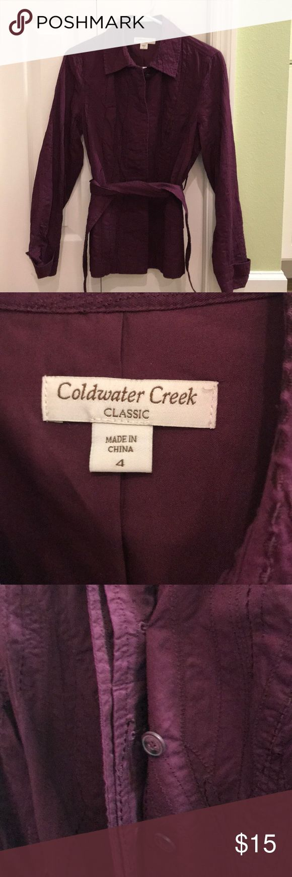 Coldwater Creek Sz. 4 Maroon belted jacket. Never worn the Coldwater Creek Size 4 long sleeved, maroon/burgundy jacket is very textual with machine embroidery throughout. Belted at the waist and a hidden button placket front are style features of this piece. The fabric is cotton with a rayon lining and the jacket it machine washable. Really a timeless piece. Coldwater Creek Jackets & Coats Utility Jackets