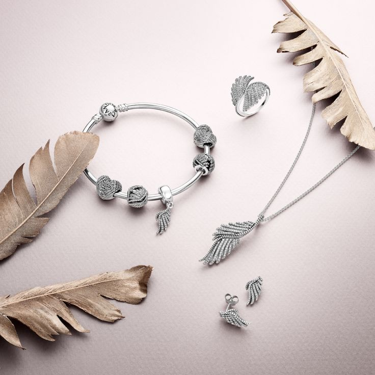 PANDORA's sparkling feather set in sterling silver and cubic zirconia is a stunning interpretation of the mythical firebird, the phoenix. These majestic pieces are made to impress. #PANDORAbracelet #PANDORAring #PANDORAnecklace #PANDORAearrings