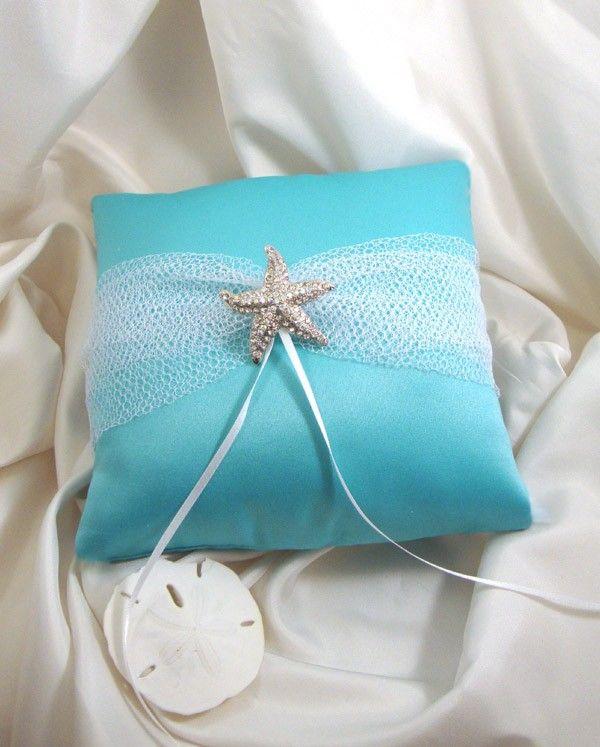 Destination Beach Wedding Ring Bearer Pillow with Rhinestone Starfish Brooch. $32.50, via Etsy.