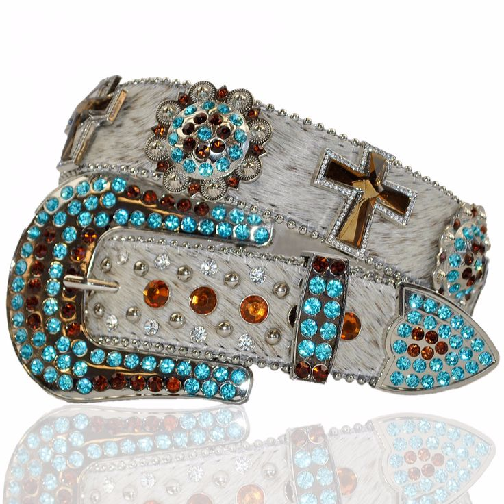 www.thewesternboutique.com  White Belt with Turquoise and Amber Conchos. Belt  with and Crystal Rhinestones Chonchos.  The Western Boutique offers a wide selection of beautiful Texas and Rodeo style Cowgirl Bling Belts. Made of genuine leather and cowhide. These western belts feature Rhinestones, Crystals, Crosses, Conchos, and Pistols.