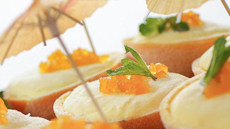Gevulde sinaasappels met mango-roomijs