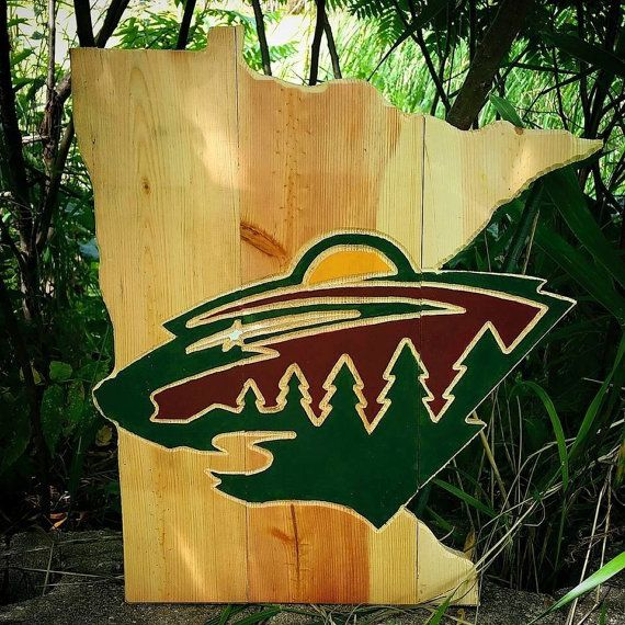 This state of Minnesota features a Minnesota Wild logo. It is 17 in height and is $70. The logo is carved and hand painted on the state. The wood is reclaimed barnwood. The color of the wood can also be requested (shade of brown - light, medium or dark). We can take any state and add a logo to us. Message for custom orders.