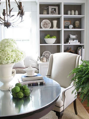 Round dining table... love it. this could work in our home... yes it could. Love the chairs & gray beadboard in cabinets.