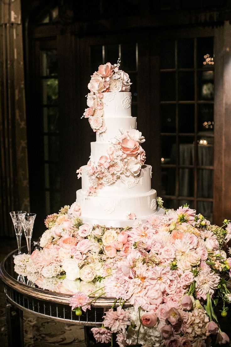 Sugar Flowers Cascading Around Tall Gorgeous Cake | Photo: Samuel Lippke Studios. View More:  http://www.insideweddings.com/weddings/elegant-alfresco-ceremony-ballroom-reception-in-dallas-texas/930/