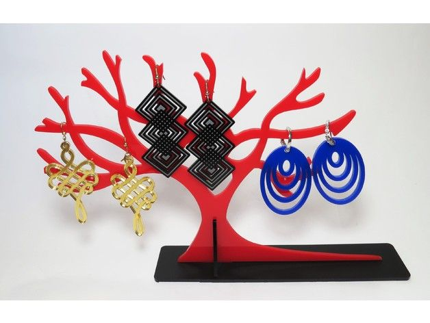 We made the jewellery display stand from the red and black acrylic sheets of 3 mm thickness. We made the earrings from blue, gold mirror and black acrylic sheets of 3 mm thickness. You can also make these products by using the material of your choice.