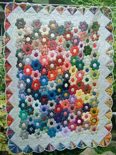 Wonderful quilt ~Great year round flower garden. :)  Looks tricky, though.   ~m