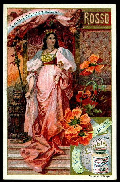 Vintage trade card, in possibly Italian, with lady in pink dress and wearing a gold crown.  Red poppies placed beside her on the stone steps.