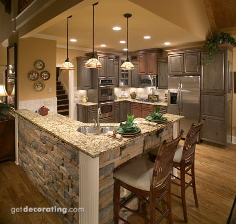 Under bar and future island: stacked stone kitchen island.L shaped island!