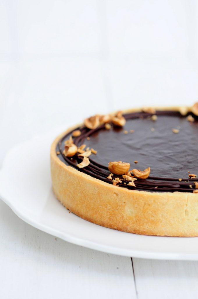 caramel chocolate tart with hazelnuts