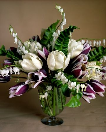 tulips, white bleeding hearts and leaves of bird's-nest fern.