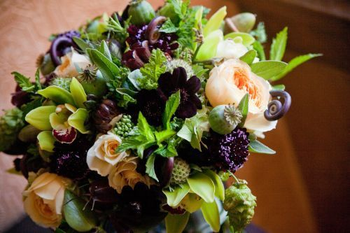 arrangement with chocolate, burgundy, butter and chartreuse flowers 1, add blue thistle...
