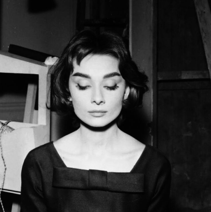 """Audrey Hepburn on the set of """"Love in the Afternoon"""" in Paris, 1956."""