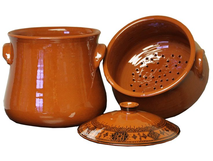 Zamouri Spices commissioned a local Moroccan artist to design this exquisite hand-made traditonal terracotta couscous pot.  It holds twelve quarts (8 quarts in the pot and 4 quarts in the steamer). It is certified Lead-free, heavy duty terracotta.  They are double fired at 1700 degrees Farenheit for extra durability.  However, we recommend gentle use and hand-washing.  DO NOT USE OVER HIGH FLAME or without a heat diffuser on a gas stove.Couscoussier, also known as Couscous pot, is a…