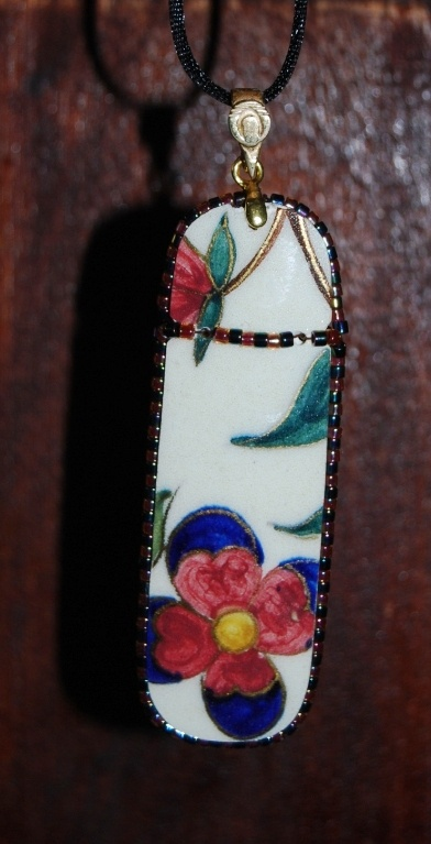 Pendant  Piece of an antique broken FISCHER porcelain with Japan pearls