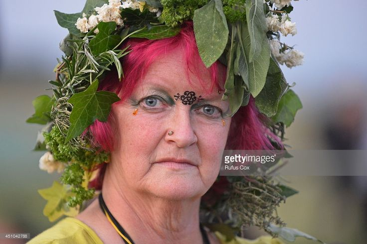 A druid pose for a photo while taking part in celebrations to mark the summer solstice at Stonehenge prehistoric monument on June 20, 2014 in Wiltshire, England. An estimated 37,000 revellers and modern day druids gathered at Stonehenge, a tradition dating back thousands of years, to celebrate the solstice and watch the sunrise.  (Photo by Rufus Cox/Getty Images)