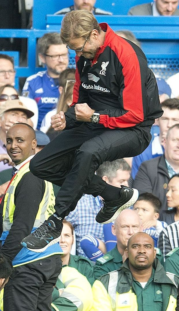 Jurgen Klopp leaps on the touchline after Liverpool's third goal.