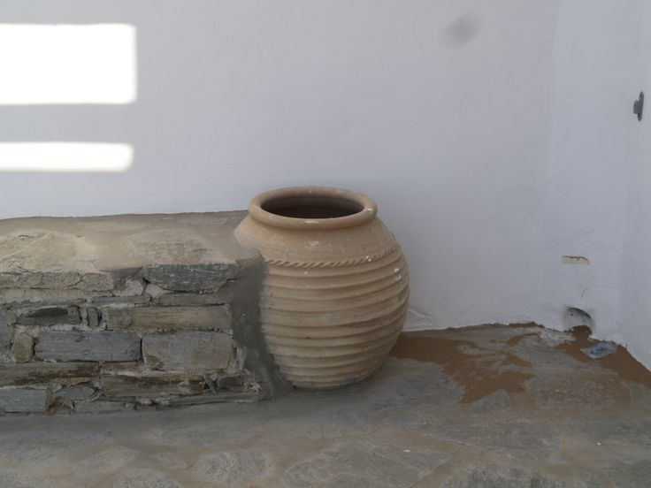 Architectural details of Cycladic residences in Paros island, Greece. Clay cask in sitting bench.