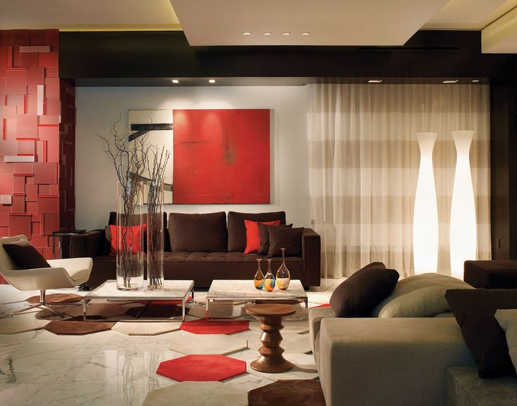 """""""Pathways"""" by artist Michael Moon adds a punch of color to one seating group in this living room, where cocktail tables topped with """"White Michelangelo"""" marble and a wood Herman Miller side table front a chocolate-brown Zanotta sofa. Sheer Kinnasand drapery fabric from Glottman provides an airy backdrop for celestial floor lamps by Serralunga."""