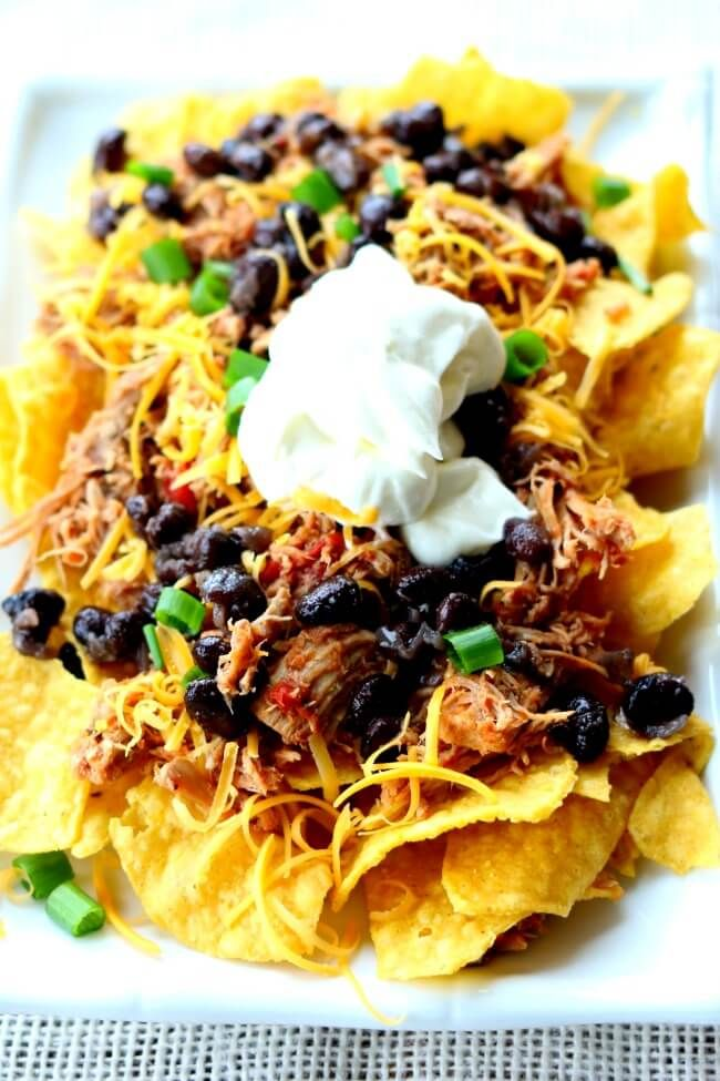 Instant PotMexican Pulled Pork--fall apart tender pork is cooked in your pressure cooker and then a diced tomatoes with jalapenos are added.