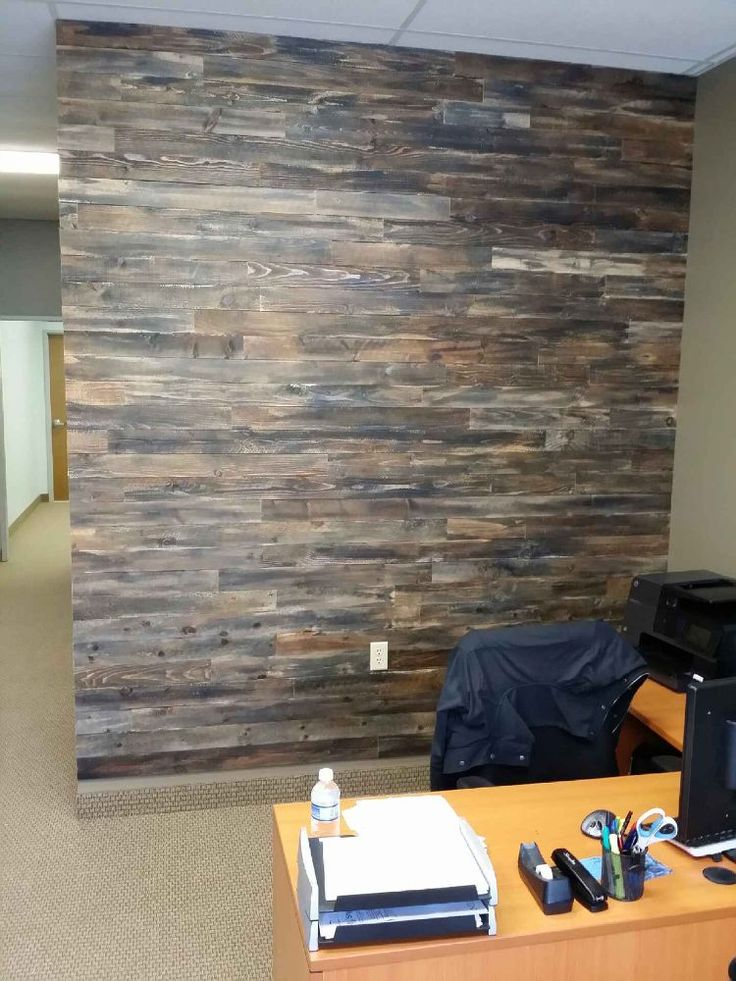 Randomly Stained Pallet Wood For An Accent Wall