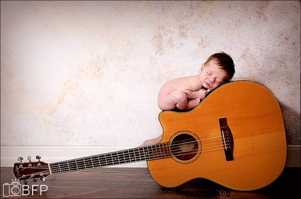 Guitar and baby.  Love it when personal objects are used.