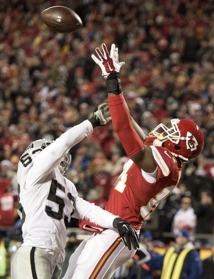 Oakland Raiders outside linebacker Malcolm Smith (53) tried to break-up a pass as Kansas City Chiefs tight end Demetrius Harris (84) waits for the ball to arrive while scoring a touchdown in the third quarter during the Kansas City Chiefs and Oakland Raiders football game at Arrowhead Stadium on January 3, 2016 in Kansas City, Missouri.
