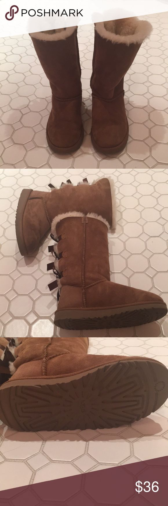 Bailey Bow UGGS - Brown - Tall I only wore these shoes a handful of times! These are real UGGS that I bought at Dillard's a few years back (these are even still available on Dillard's). They are so cute but I jut grew out of them too fast! PLEASE FEEL FREE TO MAKE OFFERS!❤️ UGG Shoes Boots