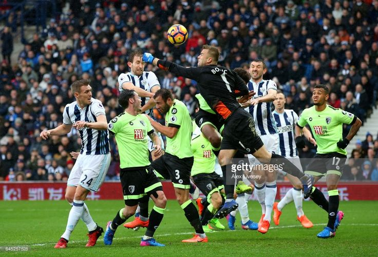 Artur Boruc of AFC Bournemouth (R) attempts to punch the ball but misses which leads to West Bromwich Albion second goal during the Premier League match between West Bromwich Albion and AFC Bournemouth at The Hawthorns on February 25, 2017 in West Bromwich, England.