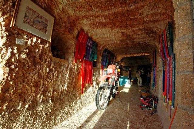 WORLD'S STRANGEST TOWNS Coober Pedy, Australia  This opal mining town has seen abandoned mines converted into homes, protecting residents from the desert heat. As mining licenses are hard to acquire, owners add 'extensions' to their homes in order to find more opals. The unique town has a population of 3,500 and over 45 different nationalities. As well as underground homes, Coober Pedy has underground museums, opal shops, art galleries, churches and, of course, opal mines.