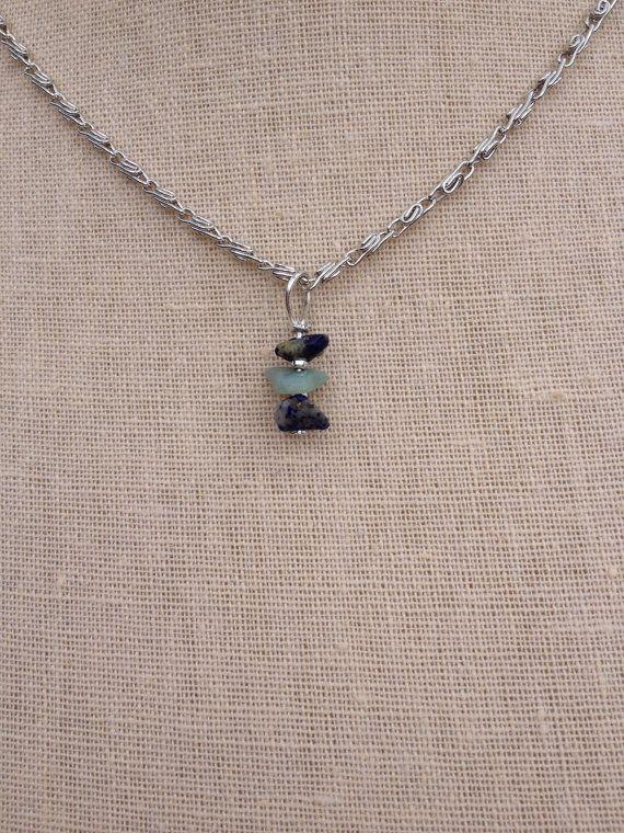 Beautiful natural gemstone chip pendant on silver chain. Chain measures 45cm  Handmade pendant measures 2x0.8cm