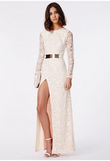 Be the belle of the ball this season with this stunning side split nude maxi dress. With luscious long transparent lace sleeves, rounded neck, cinched waist and sexy open V shaped back plunge this dress will turn heads. Style this up with t...