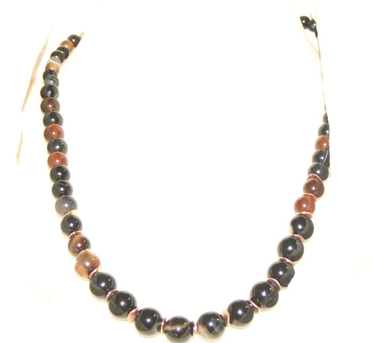 Simple but beautiful - Sardonyx Agate has rings through it, in different browns, black, oranges and white. I used copper spacers to enhance the largest beads at the front. Classic chic!