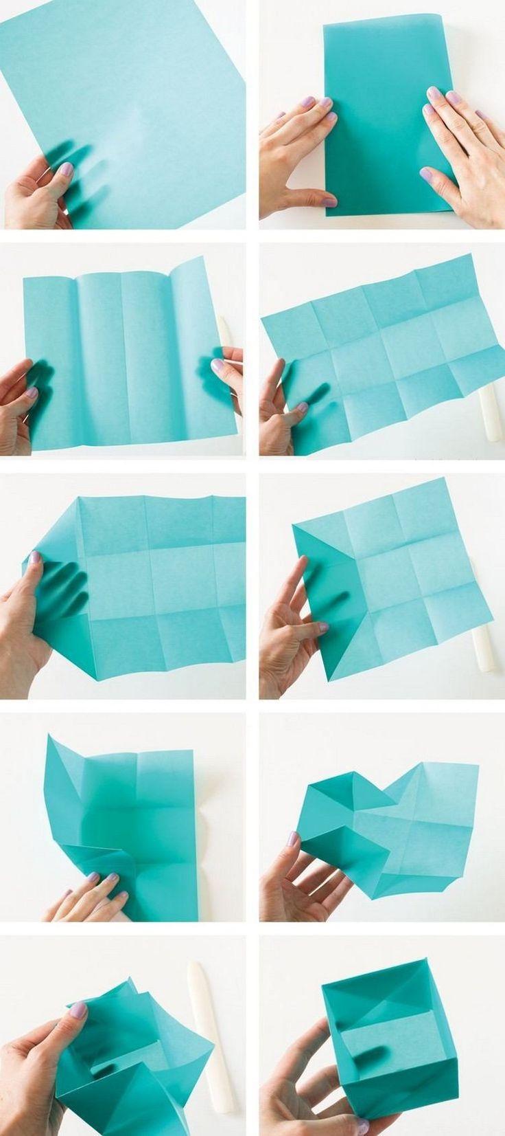 origami de Noël - comment réaliser une boîte à cadeaux en papier turquoise